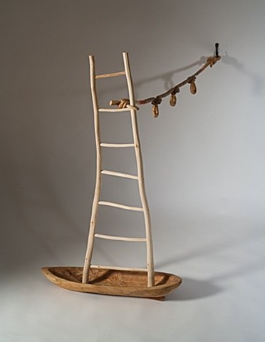 Wood sculpture of boat, ladder and knots by Lin Lisberger