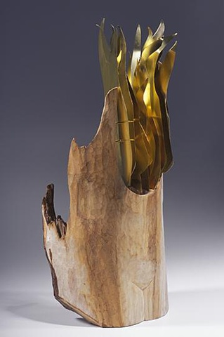 Wood sculpture about hot flashes by Lin Lisberger