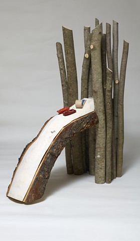 Wood sculpture about walking to a sledding hill by Lin Lisberger