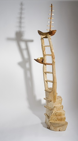Wood sculpture of ladders and boats by Lin Lisberger