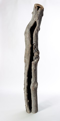Carved and burned wood sculpture about spaces between by Lin Lisberger