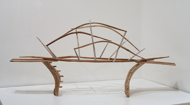 Wood sculpture of bridge and carved knots by Lin Lisberger
