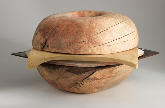 Carved wood sculpture about sandwiches by Lin Lisberger