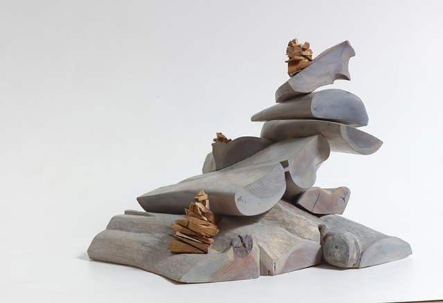 Wood sculpture by Lin Lisberger about climbing the steep ledges at Baldface Mt in NH