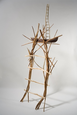 Wood sculpture of ladders and boat by Lin Lisberger