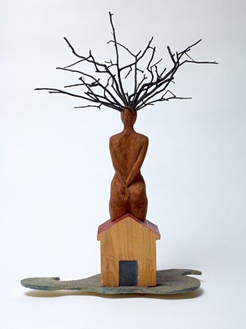 Wood sculpture by Lin Lisberger referencing Jamaica Kincaid short story