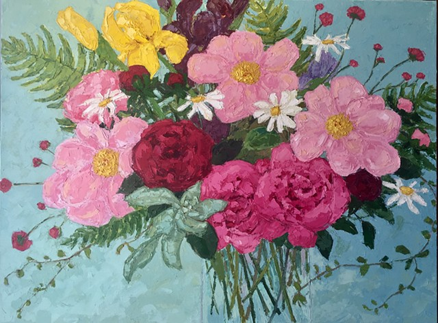 Pink peonies with mixed flowers on blue