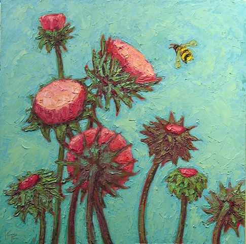 Multiple thistles with bee on blue sky