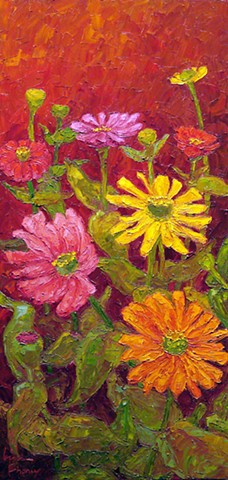 Zinnias in pink, orange, and yellow