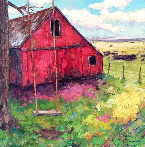 Red barn with tree swing