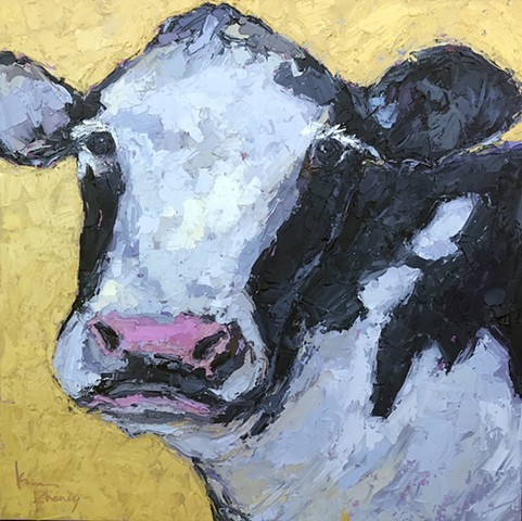 Black and White Cow on yellow