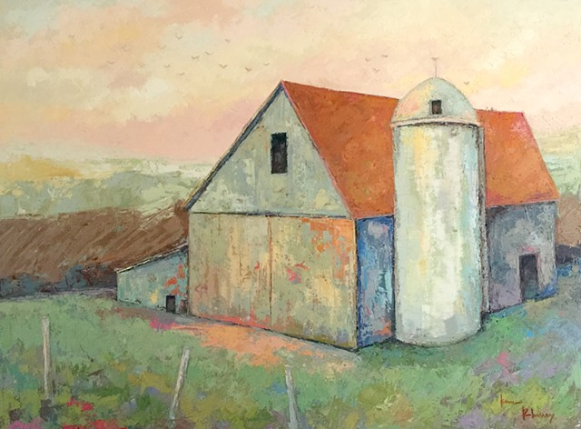 White barn, red roof with silo, pink sky