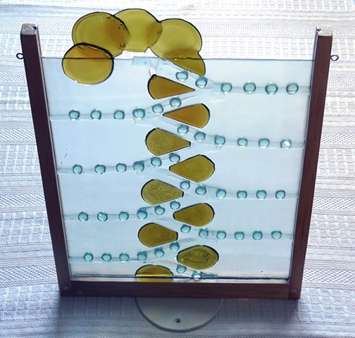 Bottle glass, aquarium buttons, wood