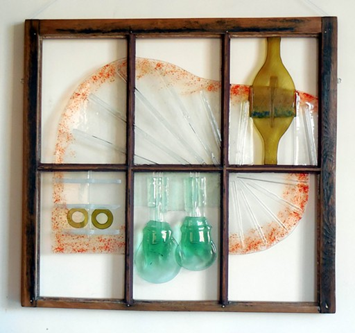bottle and plate glass, red frit, in old window.