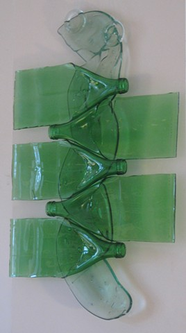 Slumped and fused bottoms, lightly slumped green bottles.