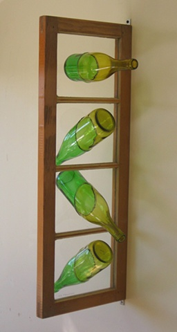 recycled bottles in old sash