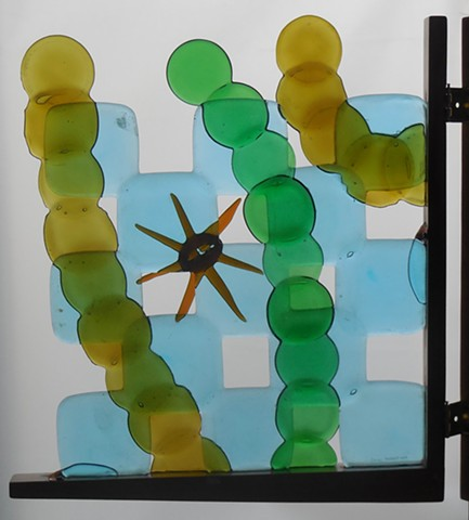 A gate.  All the glass except the brown star is bottle bottoms.