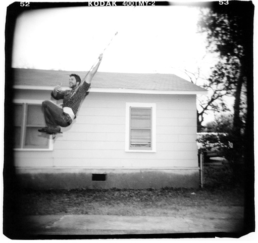Holga photo of a man on a swing
