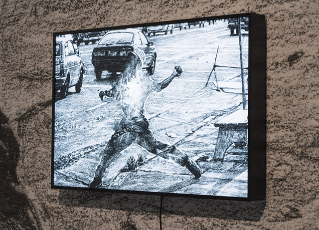 Untitled (A rioter throwing stones)