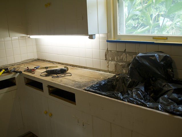 More demo, backsplash has two inches of concrete and metal lath also. Ugh!