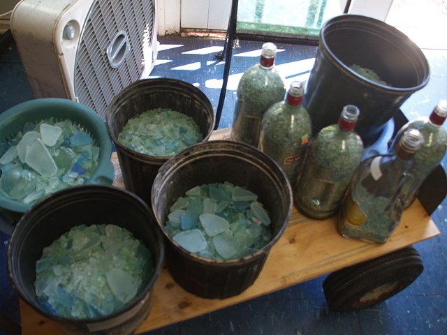 Tumbled auto glass and bottle glass is washed and dried and ready to be used.