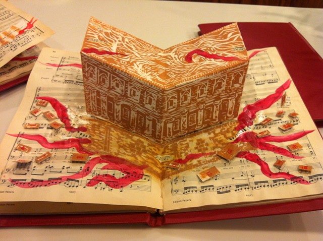 "This altered book was created, as an edition of three, for the ""Al-Mutinabbi Street Starts Here"" book arts show."