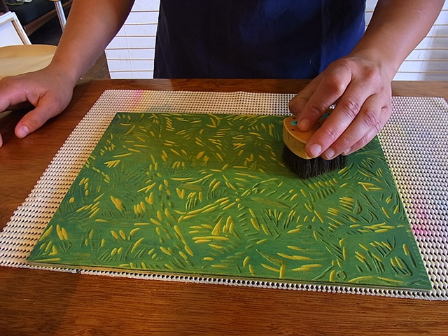 Spreading water pigment on the wood using Japanese brushes