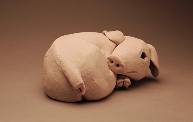 piglet curled up tight, frightened scared animal sculpture bacon ham vegan veg vegetarian anxious