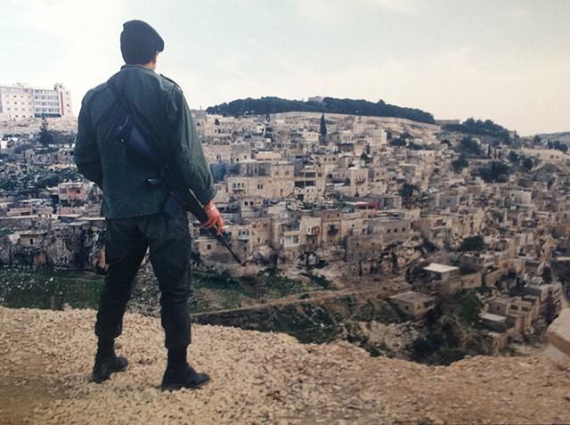 Soldier overlooking Palestine Jerusalem, Israel