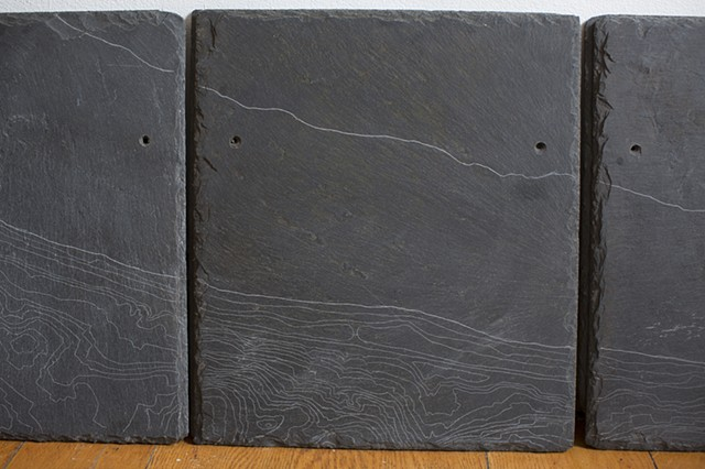Wave Hill contour lines engraved into Slate