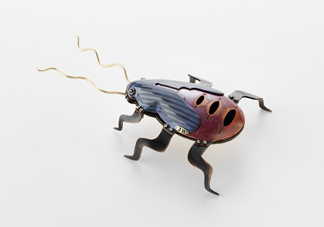 stylized version of a red-shouldered bug inspired by ones seen on camel trek in South Australia