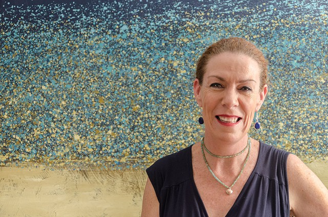 Jacinta Stewart in front of a Seascape