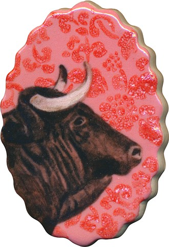 Oval ceramic handmade tile, hand painted with underglazes, bull portrait of Taurus zodiac sign with pink floral background pattern by Chantelle Norton.