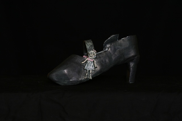 A 1930's high heeled shoe for mothers and their admirers, with baby carriage and baby