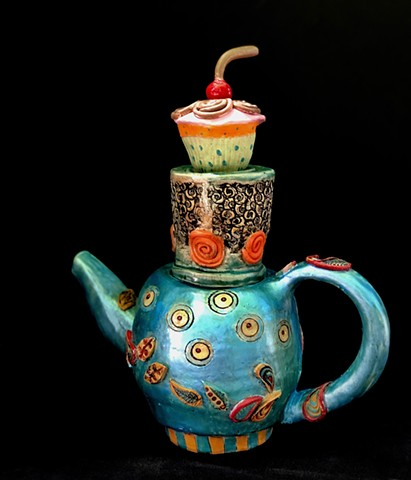Teapot with cupcake on top