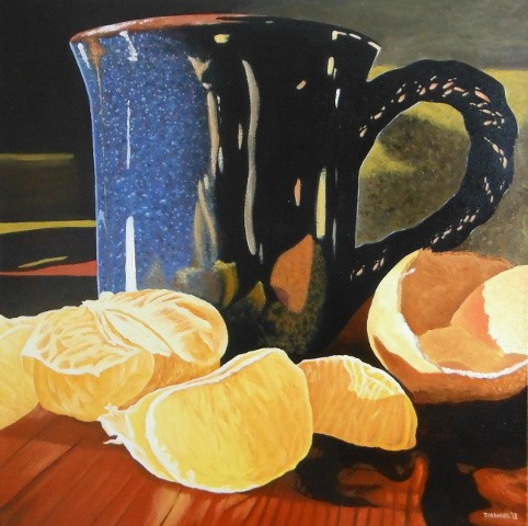Oranges and a coffee cup