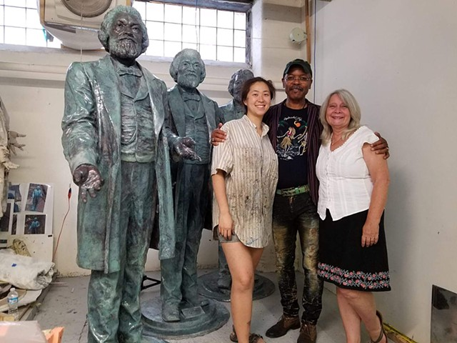 The Living Legacy of Frederick Douglass- This is inspired by the Stanley Edwards bronze. It is a life-sized representation of an older Douglass which has the hands of the living great, great, great grandson of Douglass, Ken Morris Jr.  Mr. Morris is conti