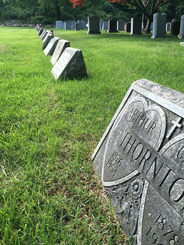 Doug Clouse, The gap in the row is the unmarked grave of well-known graphic designer E. McKnight Kauffer (1890-1954) in Woodlawn Cemetery, the Bronx.