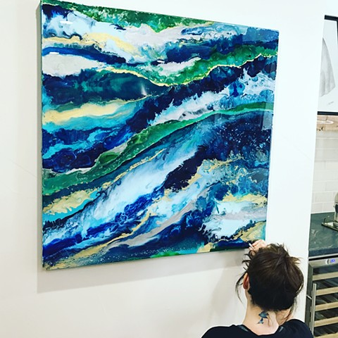 Suzie signing one of her newest art pieces in 2017