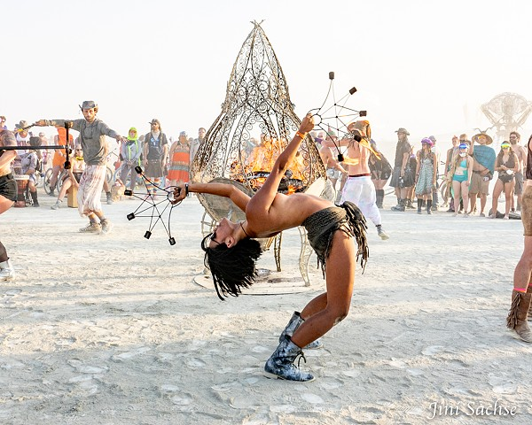 fire dancer, semi-nude, burning man
