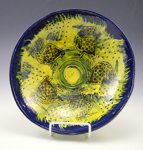 African bird bowl in yellow and blue and black