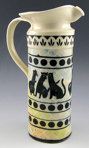 cat pitcher with multicolor background