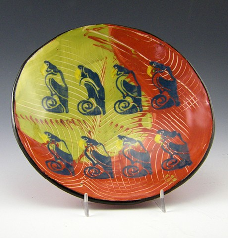 parrot design bowl in red, yellow and black