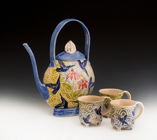 vivid blue collaged hummingbird teapot  with four footed cups