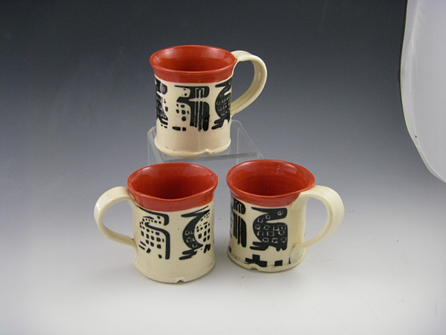bright and cheery red and black mugs