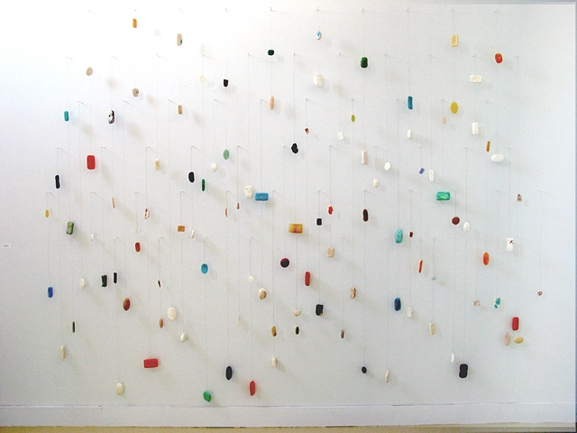 Large sculptural works often based on wall grids - mathematical grids plotted, drawn and then drilled directly into the gallery walls - with a multiplicity of materials and found objects falling into the viewers space to create a three dimensional languag