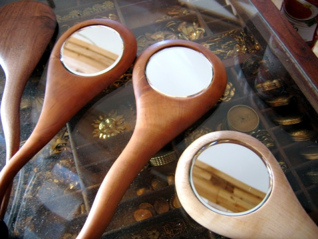 sculpted handheld beveled mirrors Cherry,Walnut, Maple, turned finials in various combinations (can be made to order)