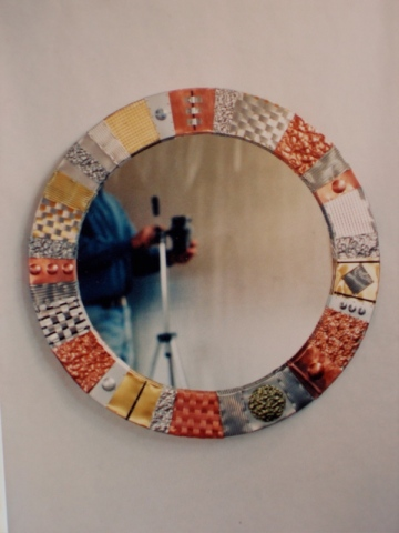 round mirror created with recycled metals hammered, woven using copper, aluminum etc. SOLD