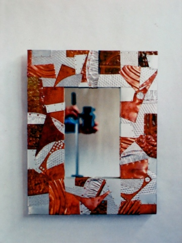 smaller size rectangular mirror made from individually cut recycled metals such as copper aluminum etc. SOLD