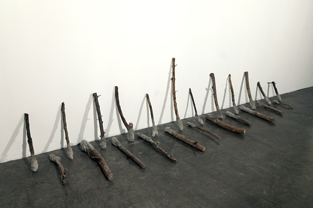 found sticks, hand dipped in cement mabe by missy engelhardt